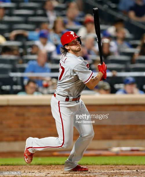 Aaron Nola of the Philadelphia Phillies drives in three runs on this double in the fifth inning during an MLB baseball game against the New York Mets...