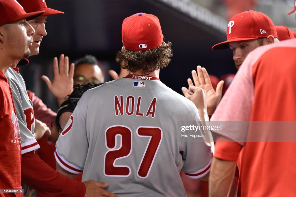 Aaron Nola #27 of the Philadelphia Phillies is congratulated by teammates after leaving the game in the eighth inning against the Miami Marlins at Marlins Park on May 2, 2018 in Miami, Florida.