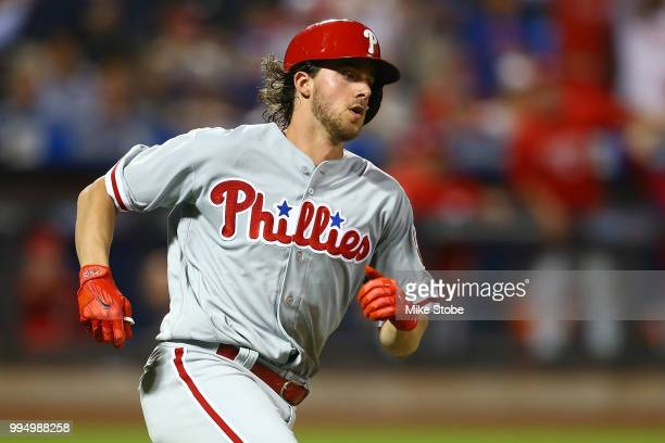 Aaron Nola of the Philadelphia Phillies rounds first base on his threerun double in the fifth inning against the New York Mets during game two of a...