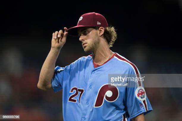 Aaron Nola of the Philadelphia Phillies tips his hat to the crowd after being taken out of the game in the top of the eighth inning against the...