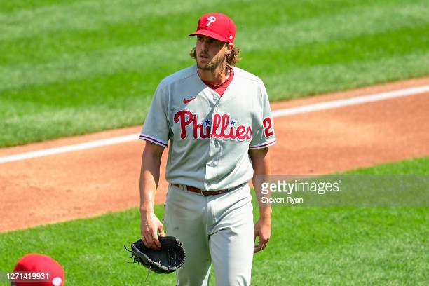 Aaron Nola of the Philadelphia Phillies walks off the field after retiring the side against the New York Mets at Citi Field on September 06, 2020 in...