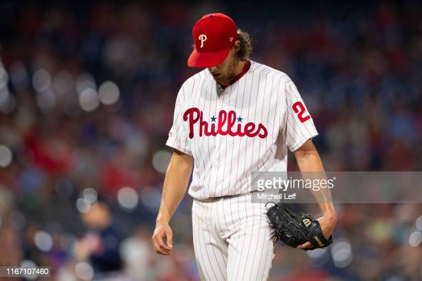 Aaron Nola of the Philadelphia Phillies walks to the dugout after the end of the top of the second inning against the Atlanta Braves at Citizens Bank...