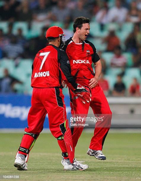 Aaron O'Brien and Graham Manou of South Australian Redbacks celebrate the wicket of Sachin Tendulkar during the Airtel Champions League Twenty20...