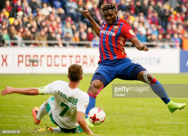 Aaron Olanare of PFC CSKA Moscow challenged by Pavel Golyshev of FC Tom Tomsk during the Russian Premier League match between PFC CSKA Moscow and FC...