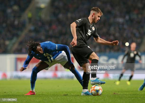 Aaron Opoku of Hansa Rostock and Patrick Kammerbauer of Eintracht Braunschweig battle for the ball during the 3 Liga match between Hansa Rostock and...