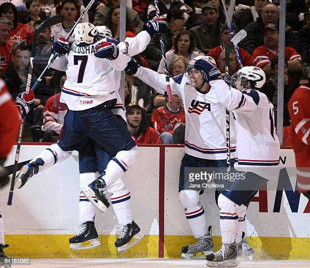 Aaron Palushaj of Team USA celebrates his team's goal with teammates Jimmy Hayes, Eric Tangradi and Mitch Wahl in a game against Team Canada during...