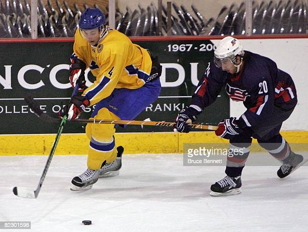 Aaron Palushaj of Team USA checks Victor Hedman of Team Sweden at the USA Hockey National Junior Evaluation Camp on August 9, 2008 at the Olympic...