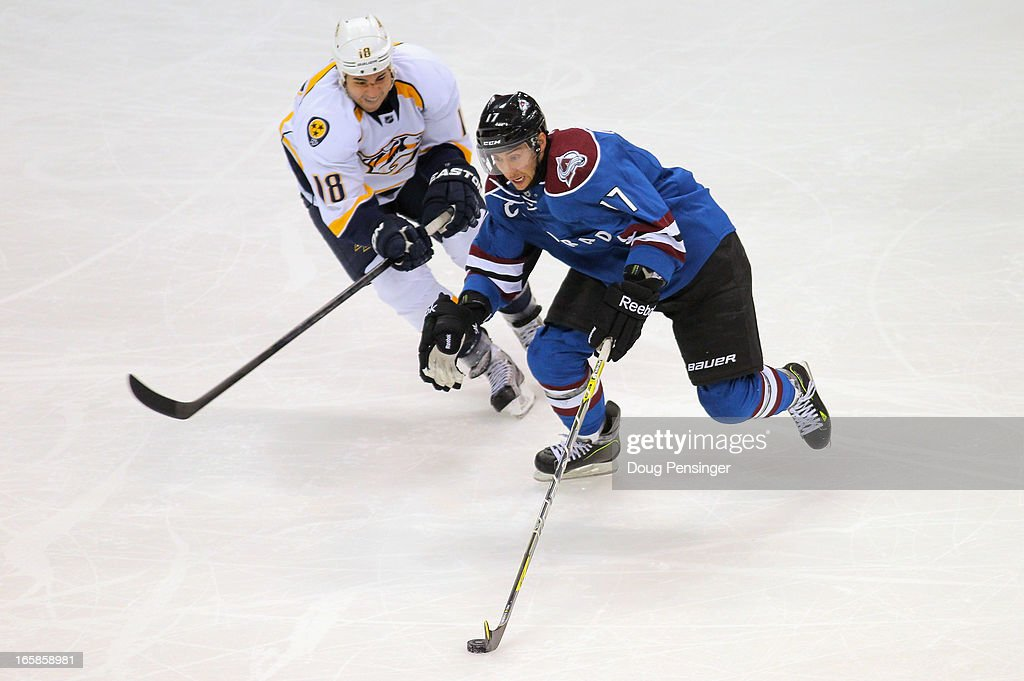 Aaron Palushaj #17 of the Colorado Avalanche controls the puck against Brandon Yip #18 of the Nashville Predators at the Pepsi Center on March 30, 2013 in Denver, Colorado. The Avalanche defeated the Predators 1-0 in overtime.