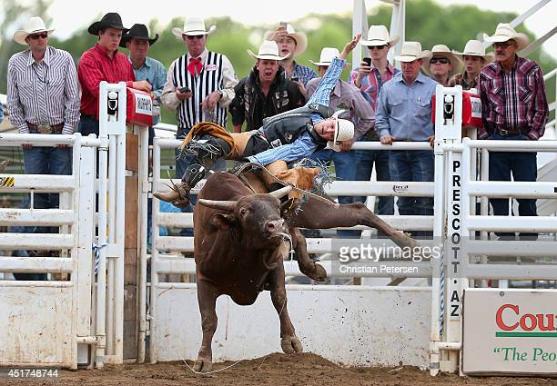Aaron Pass competes in the Bull Riding at the Prescott Frontier Days 'World's Oldest Rodeo' on July 5 2014 in Prescott Arizona