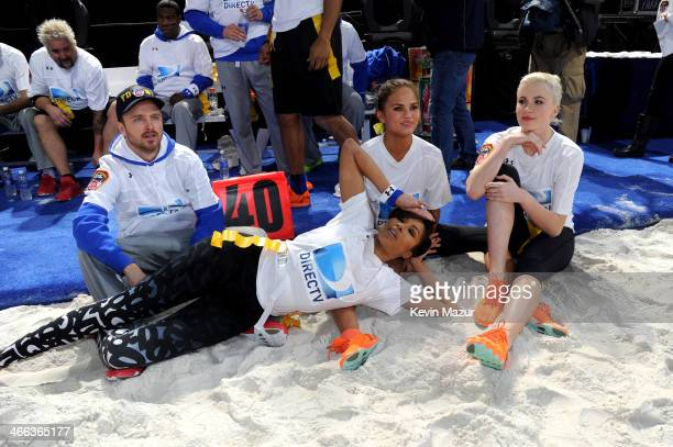 Aaron Paul Alicia Quarles Chrissy Teigen and Ireland Baldwin participate in the DirecTV Beach Bowl at Pier 40 on February 1 2014 in New York City