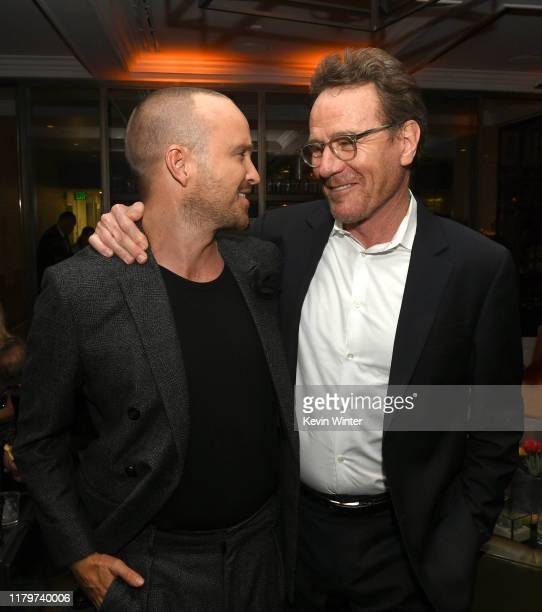 """Aaron Paul and Bryan Cranston pose at the after party for the premiere of Netfflix's """"El Camino: A Breaking Bad Movie"""" at Baltaire on October 07,..."""