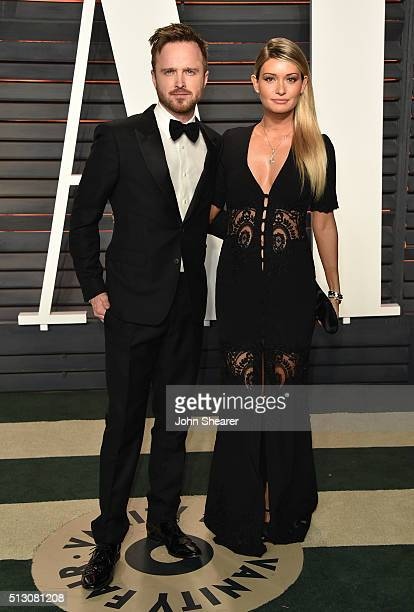 Aaron Paul and Lauren Parsekian arrive at the 2016 Vanity Fair Oscar Party Hosted By Graydon Carter at Wallis Annenberg Center for the Performing...