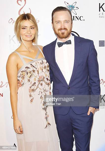 Aaron Paul and Lauren Parsekian arrive at the Open Hearts Foundation 4th Annual Gala held on May 10 2014 in Malibu California