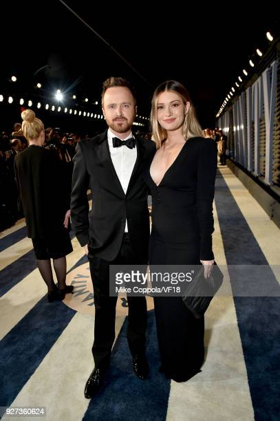 Aaron Paul and Lauren Parsekian attend the 2018 Vanity Fair Oscar Party hosted by Radhika Jones at Wallis Annenberg Center for the Performing Arts on...