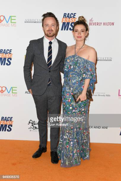 Aaron Paul and Lauren Parsekian attend the 25th Annual Race To Erase MS Gala at The Beverly Hilton Hotel on April 20 2018 in Beverly Hills California