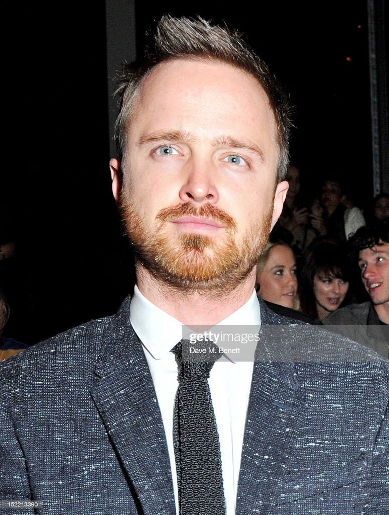 Aaron Paul attends the Burberry Spring Summer 2013 Womenswear Show Front Row at Kensington Gardens on September 17, 2012 in London, England.
