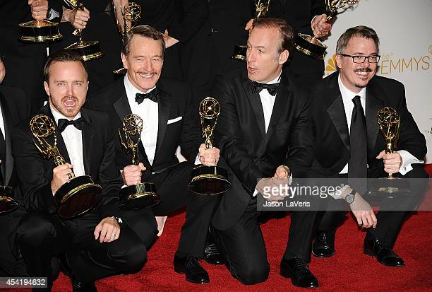 Aaron Paul, Bryan Cranston, Bob Odenkirk and Vince Gilligan pose in the press room at the 66th annual Primetime Emmy Awards at Nokia Theatre L.A....