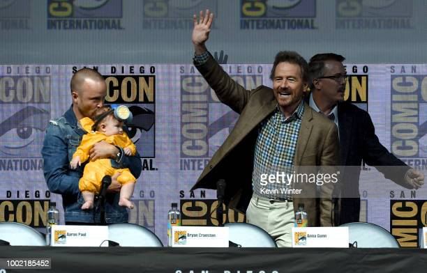 Aaron Paul with baby Story Annabelle Paul Bryan Cranston and Vince Gilligan walk offstage at the 'Breaking Bad' 10th Anniversary Celebration during...