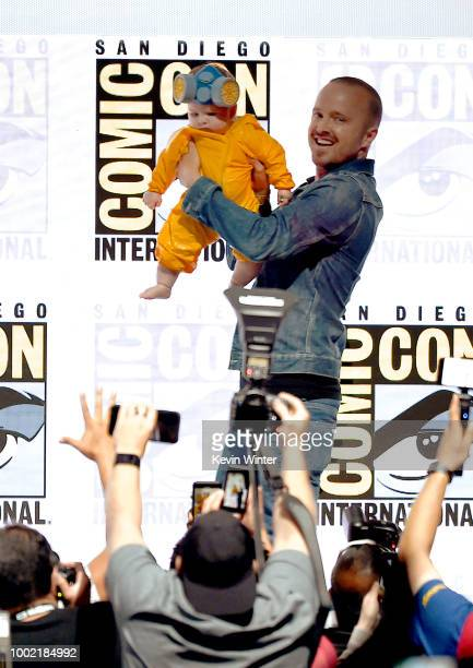Aaron Paul with baby Story Annabelle Paul walks onstage at the Breaking Bad 10th Anniversary Celebration during ComicCon International 2018 at San...