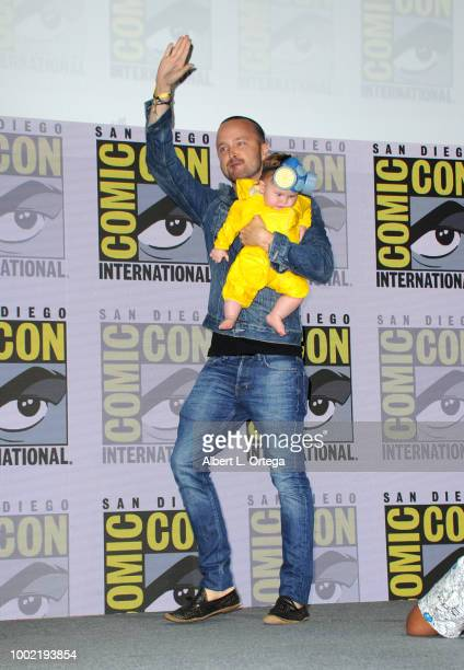 Aaron Paul with baby Story Annabelle Paul walks onstage at the 'Breaking Bad' 10th Anniversary Celebration during ComicCon International 2018 at San...