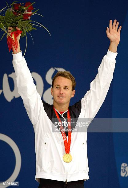 Aaron Peirsol of the United States poses with the gold medal during the medal ceremony for the Men's 100m Backstroke held at the National Aquatics...