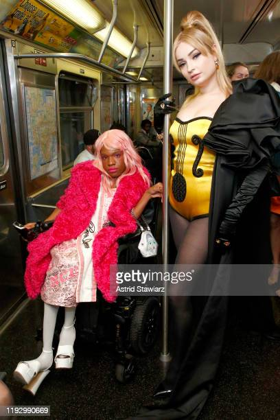 Aaron Philip and Kim Petras attend the Moschino Prefall 2020 Runway Show front row at New York Transit Museum on December 09, 2019 in Brooklyn City.