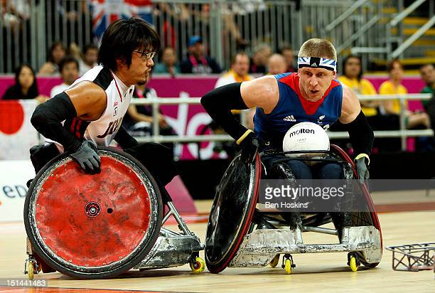 Aaron Phillips of Great Britain holds off pressure from Daisuke Ikezaki of Japan during the Men's Pool Phase Group A match between Great Britain and...