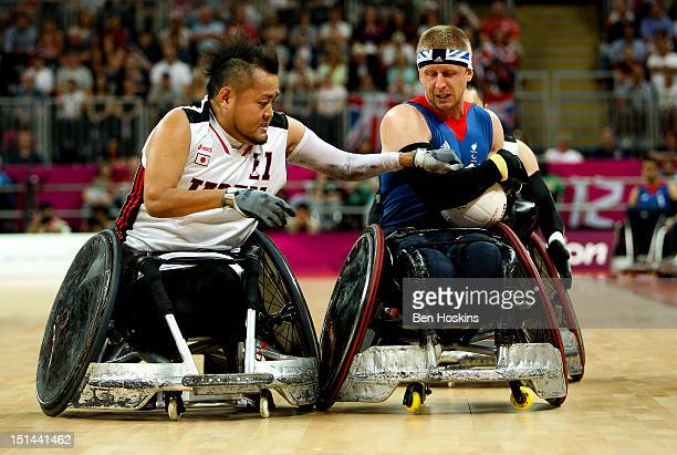 Aaron Phillips of Great Britain shields the ball from Shin Nakazato of Japan during the Men's Pool Phase Group A match between Great Britain and...