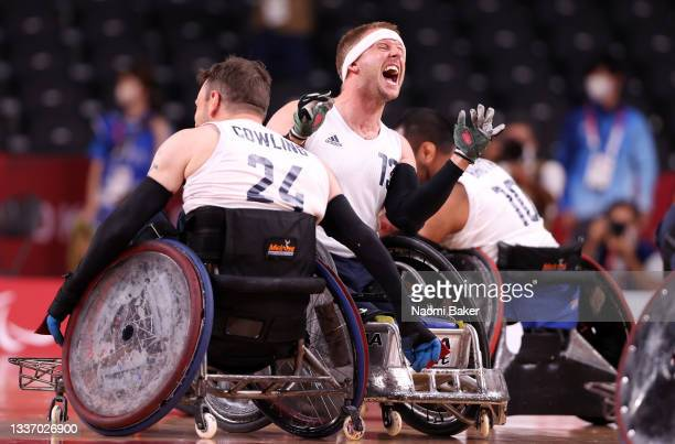 Aaron Phipps of Team Great Britain celebrates with teammates after defeating Team United States during the gold medal wheelchair rugby match on day 5...