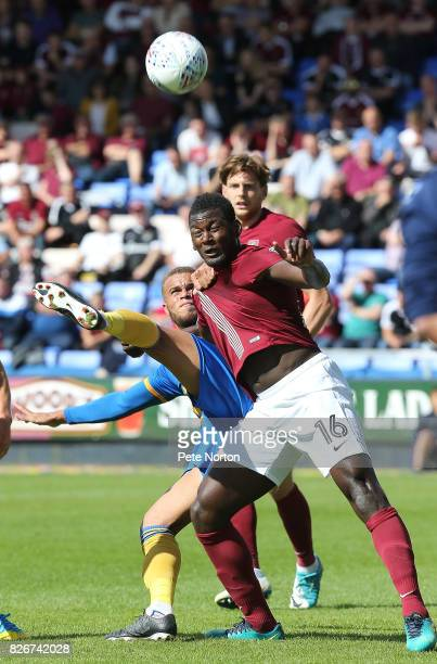 Aaron Pierre of Northampton Town heads the ball clear under pressure fron Carlton Morris of Shrewsbury Town during the Sky Bet League One match...