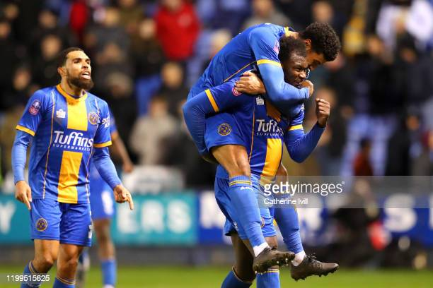Aaron Pierre of Shrewsbury Toshoots celebrates victory with his team mates after the FA Cup Third Round Replay match between Shrewsbury Town and...