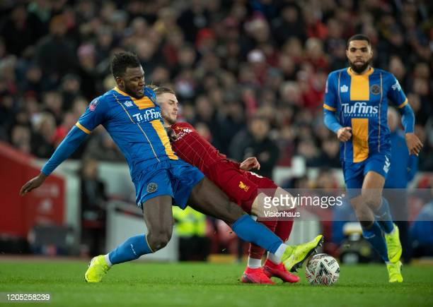 Aaron Pierre of Shrewsbury Town and Harvey Elliott of Liverpool in action during the FA Cup Fourth Round Replay match between Liverpool and...