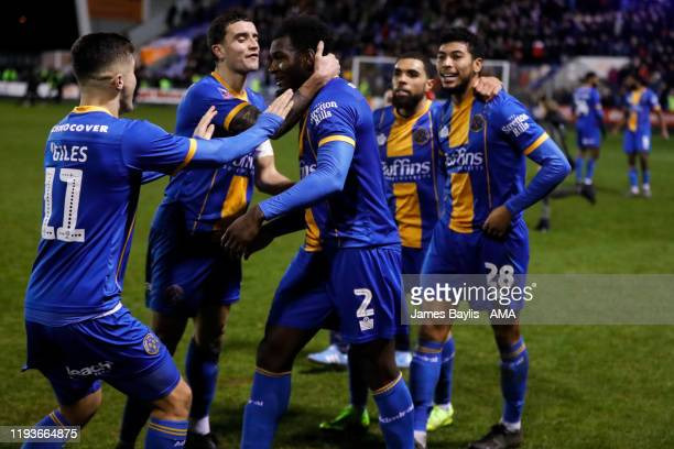Aaron Pierre of Shrewsbury Town celebrates at full time with team mates during the FA Cup Third Round Replay match between Shrewsbury Town and...