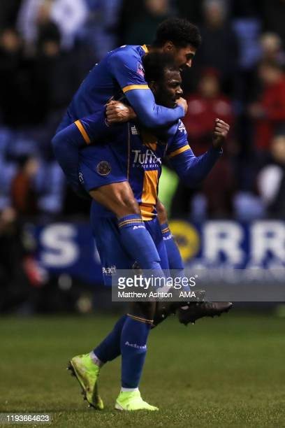 Aaron Pierre of Shrewsbury Town celebrates with team mates at full time during the FA Cup Third Round Replay match between Shrewsbury Town and...