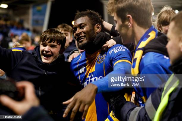 Aaron Pierre of Shrewsbury Town is mobbed by fans at full time as they celebrate during the FA Cup Third Round Replay match between Shrewsbury Town...