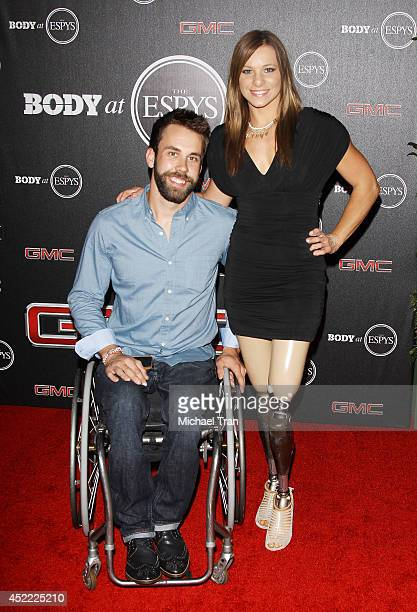 Aaron Pike and Oksana Masters arrive at the BODY at ESPYS PreParty held at Lure on July 15 2014 in Hollywood California