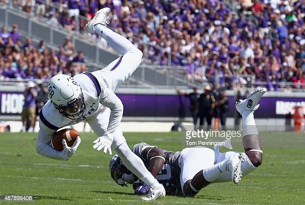 Aaron Piper of the Stephen F Austin Lumberjacks carries the ball against Derrick Kindred of the TCU Horned Frogs in the first quarter at Amon G...