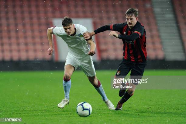 Aaron Pressley of Aston Villa battles for possession with Tom Hanfrey of AFC Bournemouth during the FA Youth Cup Fifth Round Match between AFC...