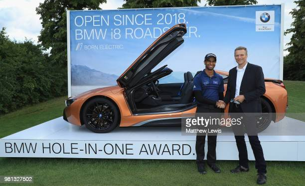 Aaron Rai of England is presented with the keys to a BMW i8 Roadster from Peter van Binsbergen Head of the German Sales Subsidiary for the BMW Group...