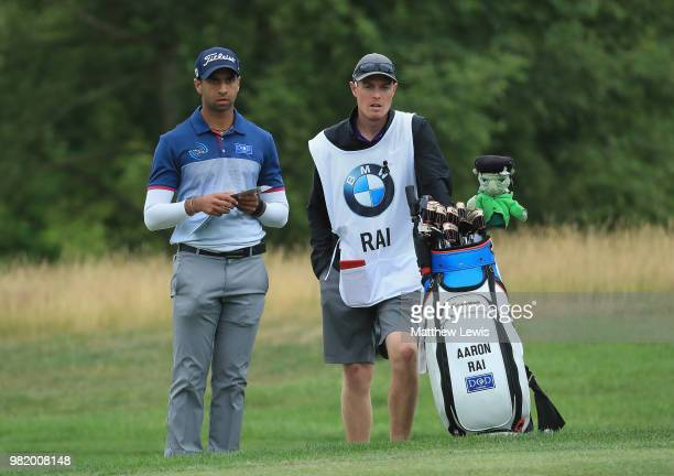 Aaron Rai of England looks on with his caddie during day three of the BMW International Open at Golf Club Gut Larchenhof on June 23 2018 in Cologne...