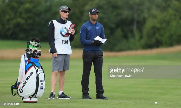 Aaron Rai of England looks on with his caddie during day two of the BMW International Open at Golf Club Gut Larchenhof on June 22 2018 in Cologne...