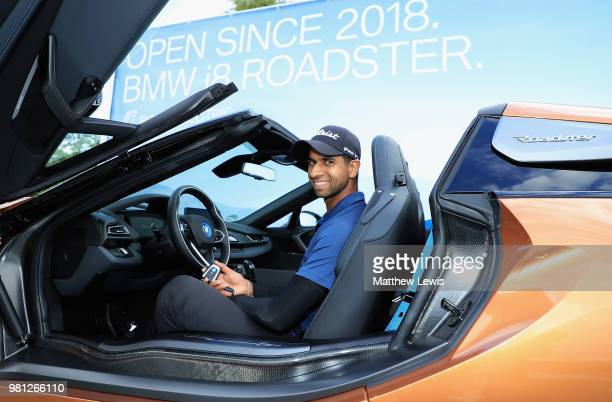 Aaron Rai of England pictured with the keys to a BMW i8 Roadster after making a 'Hole in one' on the 16th hole during day two of the BMW...