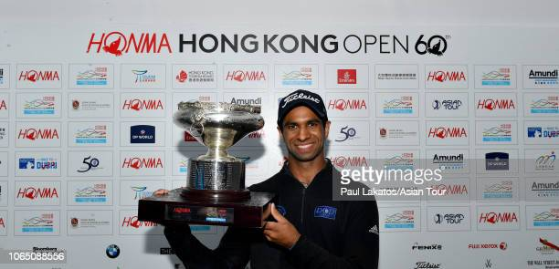 Aaron Rai of England pictured with the winner's trophy during the final round of the HONMA Hong Kong Open presented by Amundi at Hong Kong Golf Club...