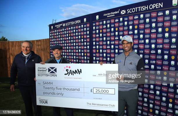 Aaron Rai of England poses with the cheque donation to SAMH charity after winning the Aberdeen Standard Investments Scottish Open at The Renaissance...