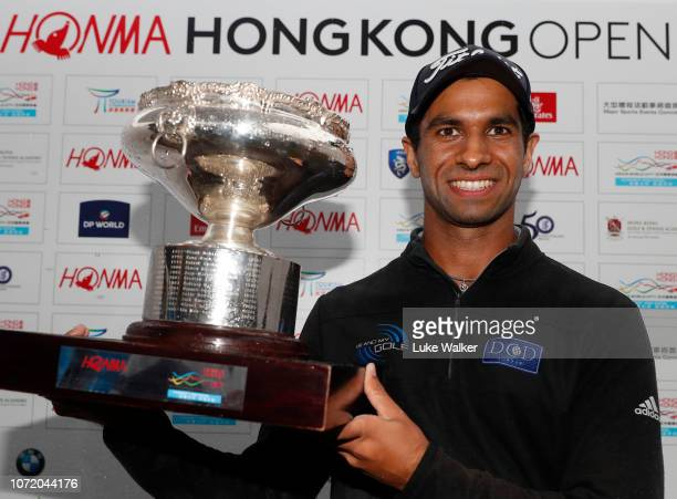 Aaron Rai of England poses with the trophy during day four of the Honma Hong Kong Open at The Hong Kong Golf Club on November 25 2018 in Hong Kong...