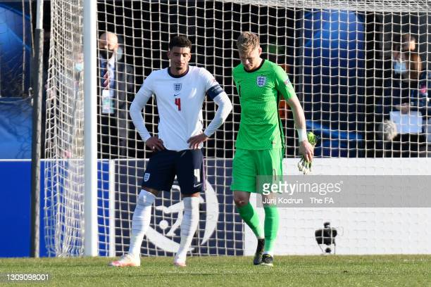 Aaron Ramsdale and Ben Godfrey of England look dejected at full time during the 2021 UEFA European Under-21 Championship Group D match between...