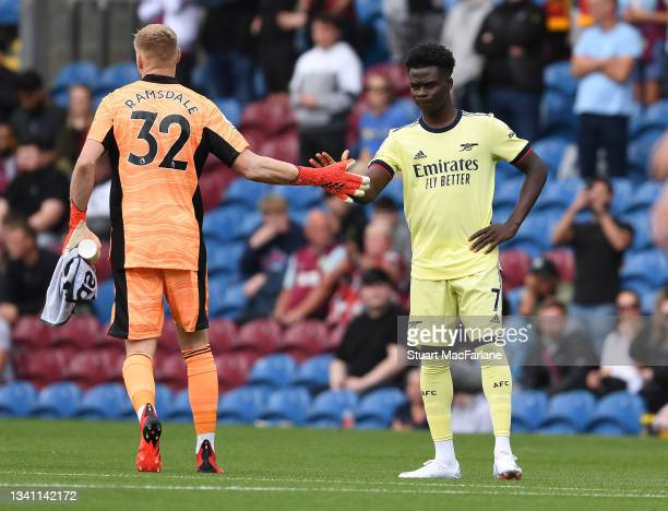 Aaron Ramsdale and Bukayo Saka of Arsenal before the Premier League match between Burnley and Arsenal at Turf Moor on September 18, 2021 in Burnley,...