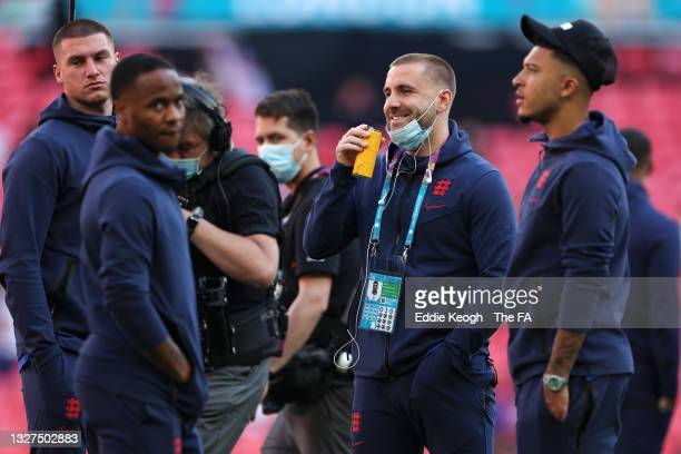 Aaron Ramsdale and Luke Shaw of England inspect the pitch prior to the UEFA Euro 2020 Championship Semi-final match between England and Denmark at...