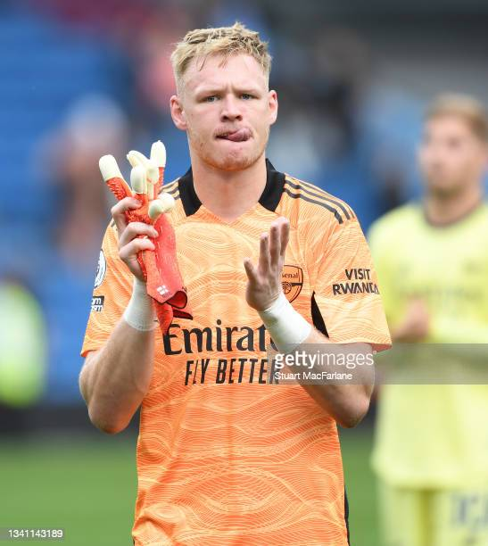 Aaron Ramsdale applauds the Arsenal fans after the Premier League match between Burnley and Arsenal at Turf Moor on September 18, 2021 in Burnley,...