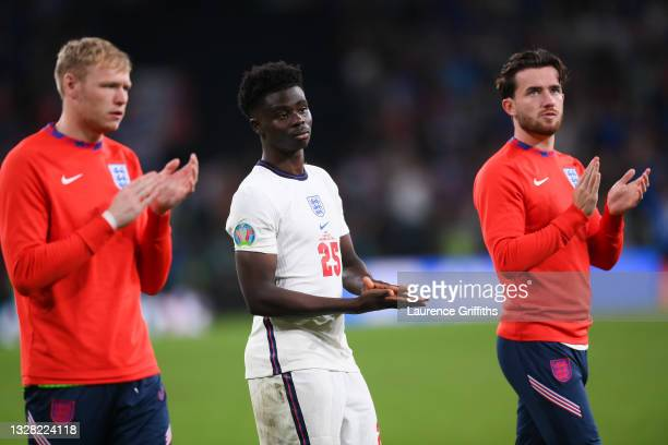 Aaron Ramsdale, Bukayo Saka and Ben Chilwell of England look dejected as they applaud fans after the UEFA Euro 2020 Championship Final between Italy...